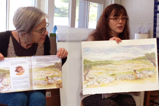 Comparing an original illustration to the printed book.